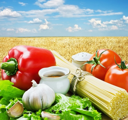 spaghetti and fresh vegetables against the cloudy sky Stock Photo - 11485176