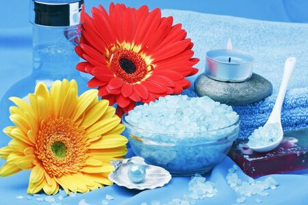 spa products, and flowers on a blue background photo