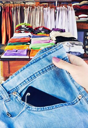 selection and purchase of fashionable clothes in a shop Stock Photo - 11737741