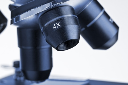 lens of the microscope isolated on a white background photo