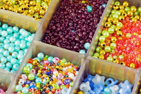 different colored beads in a gray box Stock Photo - 11737738