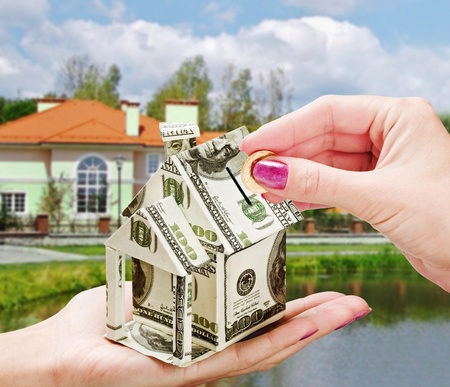 we collect money in the piggy bank on the purchase of a new home photo
