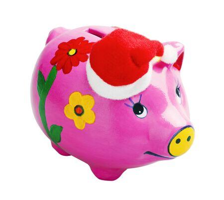 pig piggy bank in a Christmas cap Stock Photo - 11931897