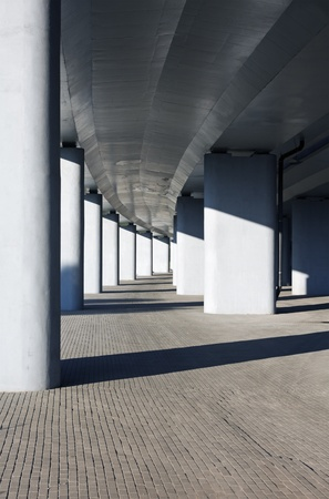 Colonnade of the vertical supports under the bridge photo