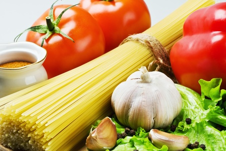 fresh garlic: spaghetti and fresh vegetables with spices on the greens
