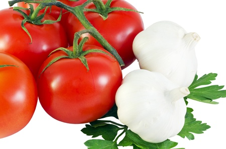 fresh tomatoes and garlic with parsley isolated on white photo