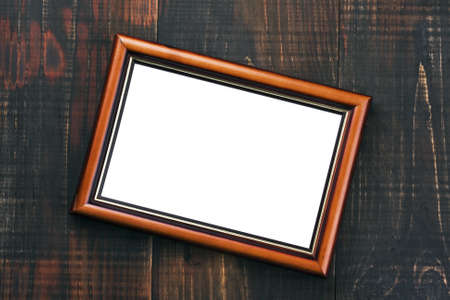 empty frame from a photo hanging on wooden wall  photo