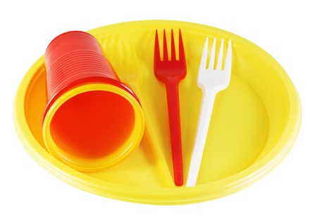 plastic plates and forks isolated on white background photo