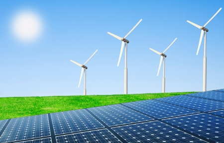 energy generation: Wind turbines and solar panels in field  Stock Photo