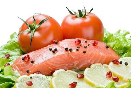 fresh red fish with lemon and vegetables isolated on white background Stock Photo - 12455368