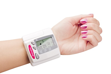 high blood pressure: tonometer on hand to measure the pressure Stock Photo