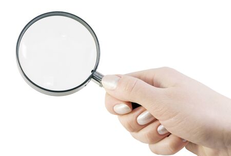 magnifying glass in hand isolated on white background Stock Photo - 12455044