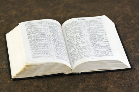 open Bible rests on a brown fabric photo