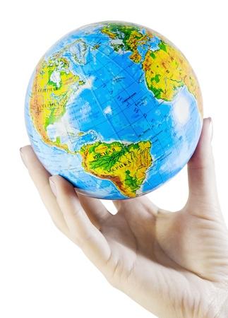 female hand holding a globe isolated on white photo