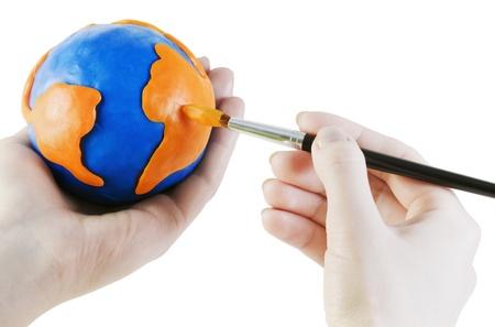 Globe paint brush is isolated on a white background photo