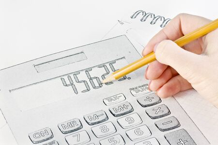 hand with a pencil drawing of business objects Stock Photo - 12457082