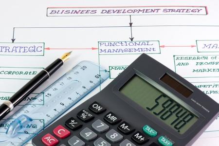 calculator, pens and pen line on a business plan Stock Photo - 12457164