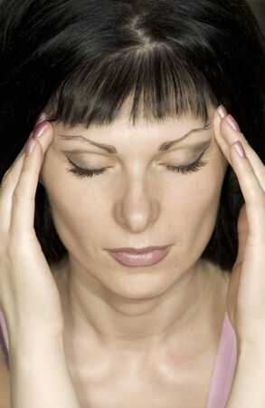 young, beautiful girl suffers headaches, migraine