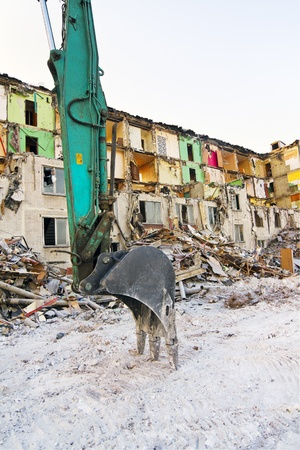 bulldoze: bucket demolition of the old and dilapidated house