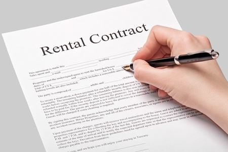 sign a rental contract on a gray background Stock Photo