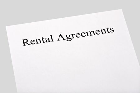 blank rental agreements isolated on gray background photo