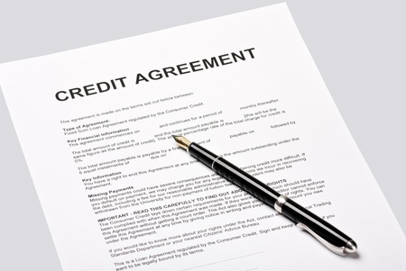 credit agreement lies for the signature on a gray background Stock Photo - 13746893