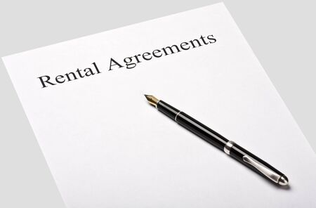 contract rental agreement is isolated on a gray background photo