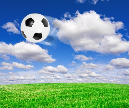 Football soccer ball under blue sky photo