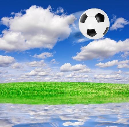 Football soccer ball under blue sky photo