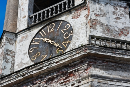 old clock on the medieval tower in the city of Vyborg, Russia photo