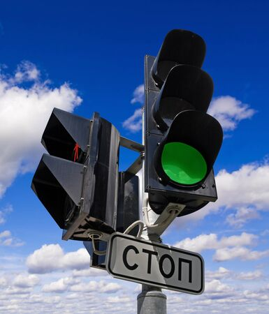 Green color on the traffic light with a beautiful blue sky in background  photo