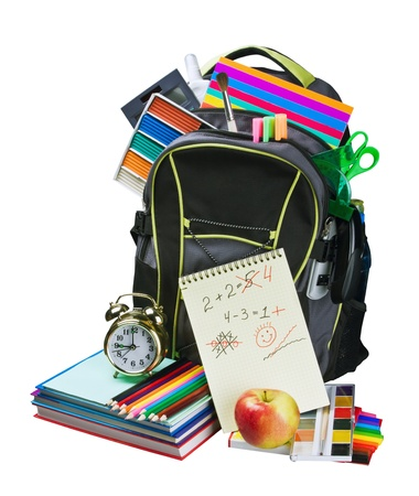 apple paper bag: Backpack full of school supplies. Shot on white background.  Stock Photo