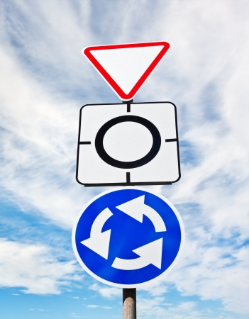 give way: Give way sign with traffic circle  Stock Photo