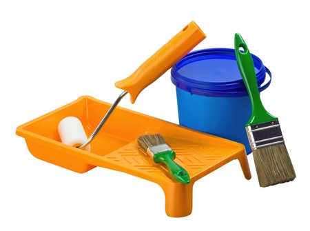 plastic cans of paint and painting tools isolated on a white background photo
