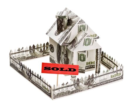 sold a house made of money isolated on white background photo