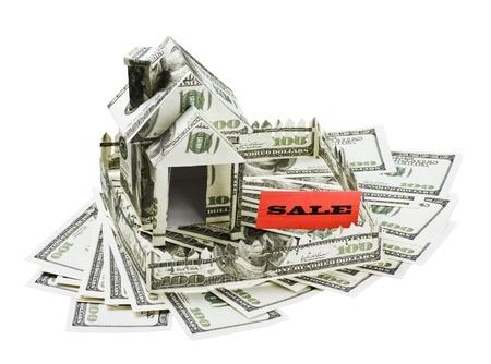 investment real state: Casa del dinero de la venta de la bandera est� en el d�lar Foto de archivo