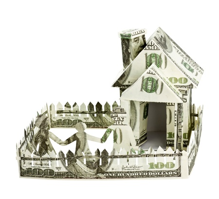 House made   of money and the family is isolated on a white background Stock Photo - 14758348