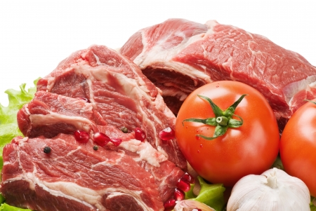 raw meat and fresh vegetables isolated on white background photo