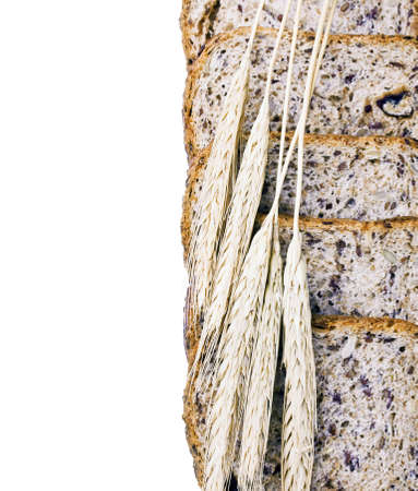 ears of wheat are on the bread and place for text photo
