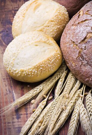 Photo: Fresh bread with ear of wheat  photo