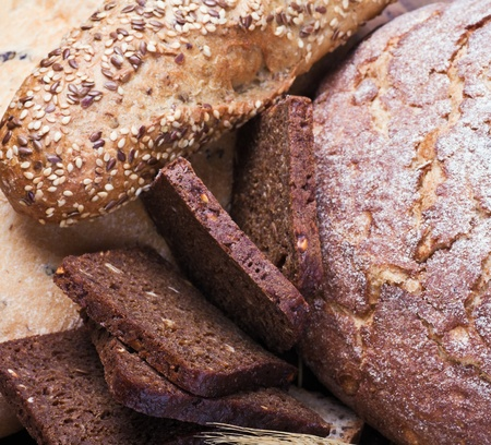 lots of fresh baked bread with seeds and spices photo