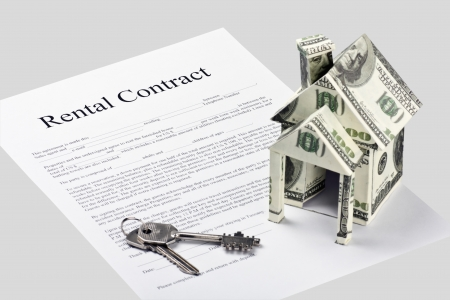 new contract: Rental contract agreement form and a house made of money Stock Photo