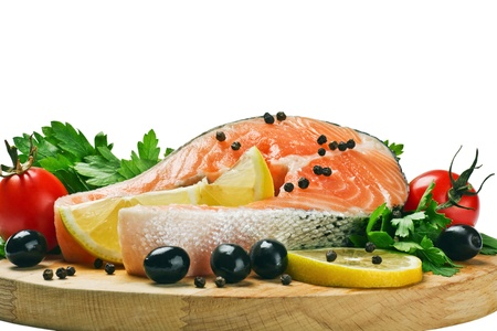 salmon steak with slices of lemon, black pepper and black olives Stock Photo - 15087190