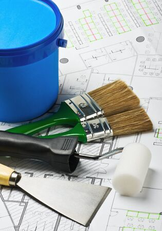 red paint roller: brushes and rollers with other tools to repair the architectural drawing Stock Photo