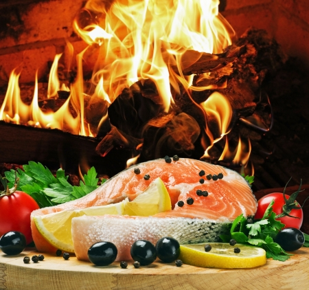 salmon steak with vegetables cooked on the grill Stock Photo