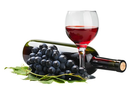 red wine bottle: glass of red wine with bottle and grape over white