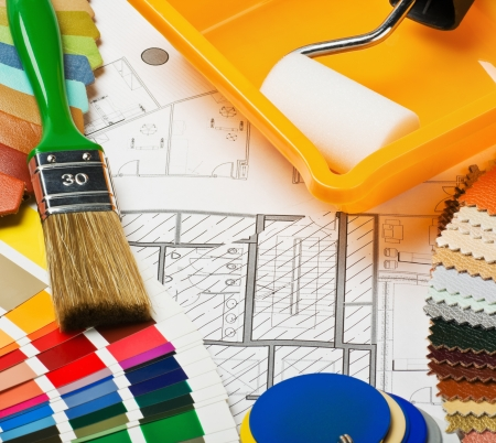 interior layout: Paints, brushes and accessories for repair to architectural drawing.This composition recommend using advertising tools and materials for the repair of articles in magazines and on the Internet. Stock Photo
