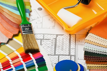 Paints, brushes and accessories for repair to architectural drawing.This composition recommend using advertising tools and materials for the repair of articles in magazines and on the Internet. Stock Photo - 15640464