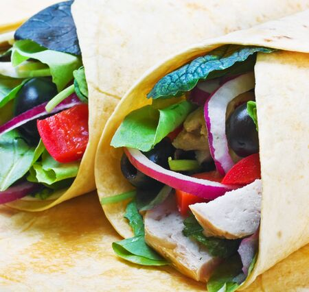 tortilla with chicken meat and fresh vegetables photo