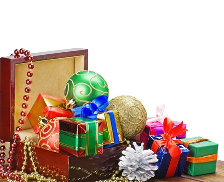 Christmas decorations, balloons and gifts in a wooden box photo